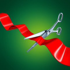 Cutting the ribbon with a green background