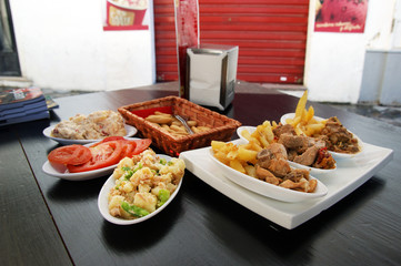 Spanish hot and cold tapas on table