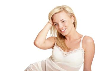 Portrait of beautiful blonde woman in beige slip