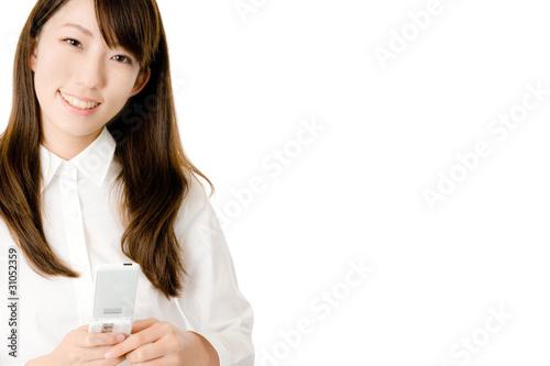 携帯電話と女性社員