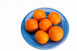 Blue plate with six oranges