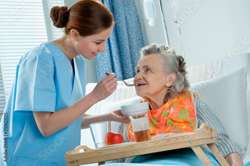 senior woman 90 years old being fed by a nurse - 31062925