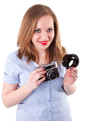 Young woman holding film and old camera