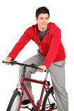 A smiling bicyclist on a bicycle posing poster