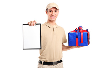 Delivery person delivering a gift box and holding a clipboard
