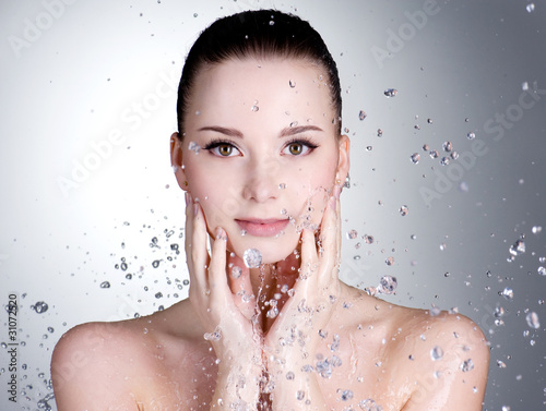 Drops of water around the beautiful woman face