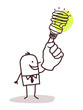 man with green light bulb on finger