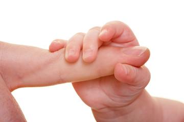 Babyfinger greifen erwachsene Hand