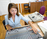 audio operator at audio control console