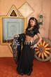 model displaying black saree and blouse