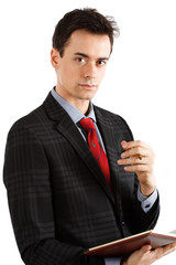 Young businessman holding pen