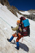 Mountaineer girl moving down on rope