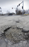 Pothole at intersection poster