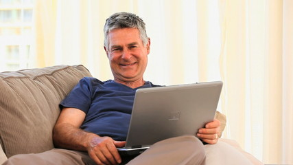 Mature man working on his laptop