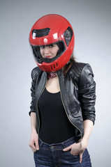smiling young motorcyclist woman posing
