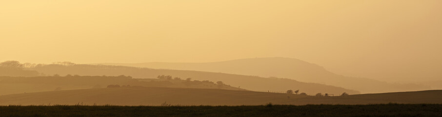 Rolling countryside landscape on hazy Summer evening