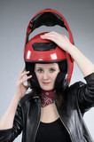 motorcyclist girl arranging visor