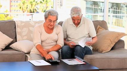 Retired couple calculating their domestics bills