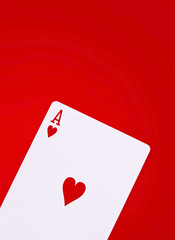 Ace of hearts on red background