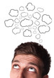 Young man with Speech Bubbles over his head