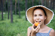 Preteen girl with apricot