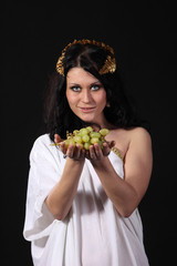 Ancient greece woman stretch a bunch of grapes