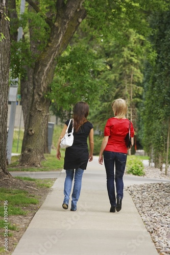 Friends Walking On The Sidewalk