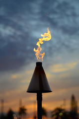 Vacation Image Of A Hawaiian Tiki Torch At Sunset