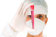 female doctor with mask holding a test tube
