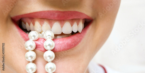 snow-white pearls of teeth