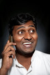 Indian man talking on the phone