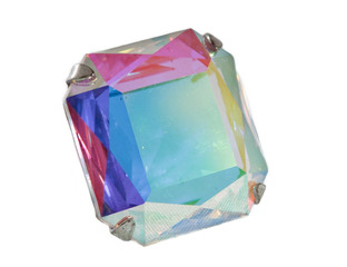 Faceted quartz with many color refractions on white background