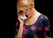 crying sad young woman in dress with handkerchief