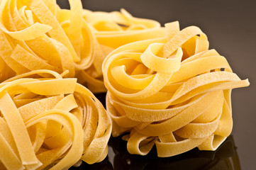 Italian pasta on a black plate background
