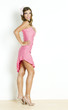 standing young woman wearing pink dress
