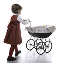 Girl vith vintage pushchair