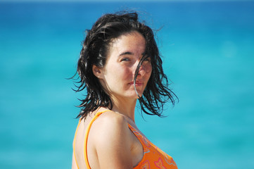 Beautiful woman portrait on a beach with sea water background