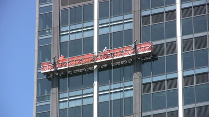 Window Repairmen Working On Office Building