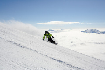 Snowboarding above the clouds