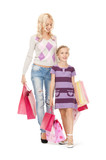 happy mother and little girl with shopping bags