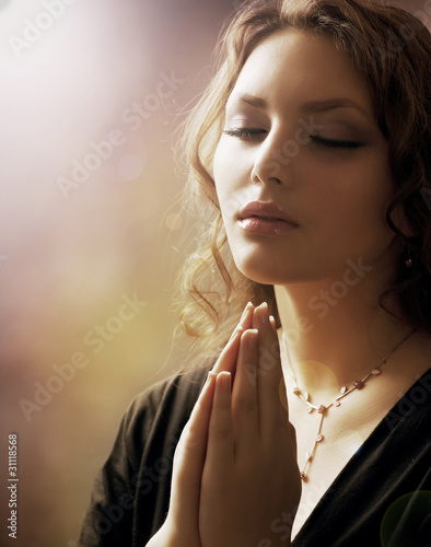 Beautiful Young Woman Praying