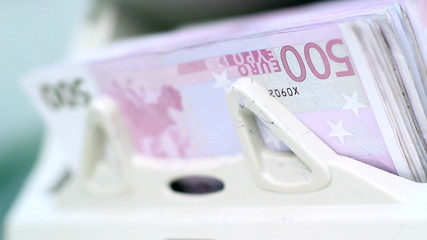 Counting A Bundle Of 500 Euro Banknotes