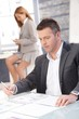 Businessman working in office sitting at desk