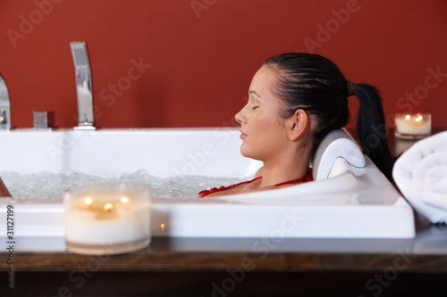 Young woman enjoying bubble bath