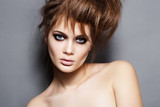 Fototapety Portrait of fashion model with tousled hair, dark punk make-up