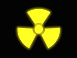 3d render of a glowing yellow radioactivity sign
