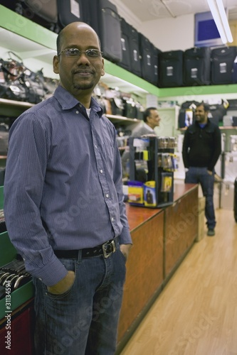 A worker in a luggage shop