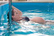 Young pregnant woman in swimming pool