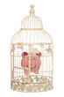 piggy bank in bird cage
