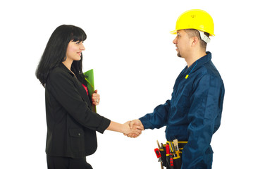 Businesswoman gives handshake with worker